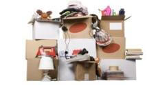 transport cardboard boxes with books and clothes, relocation concept
