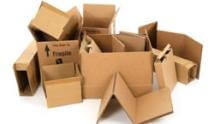 Pile of used cardboard boxes on white background.
