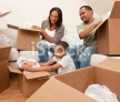 stock-photo-16082375-african-american-family-unpacking-boxes-moving-house